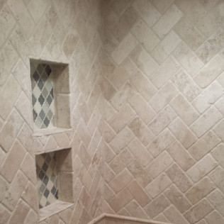beige tile shower stone in remodeled bathroom in  Gretna & Omaha, NE